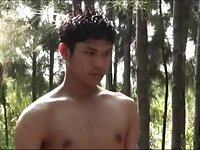 Guy jerking off in the forest