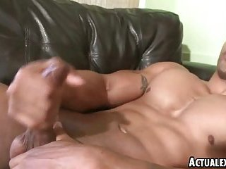 Muscular dark skinned hunk with a big hard on soloing